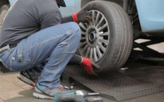 car mechanic changing tire